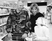A military family shops in a commissary