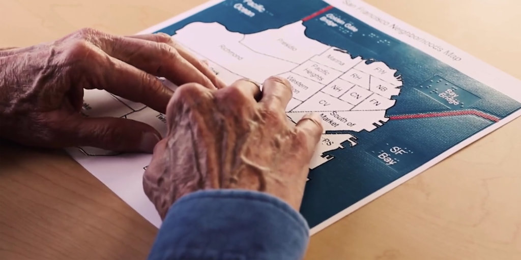hands reading a braille map of San Francisco